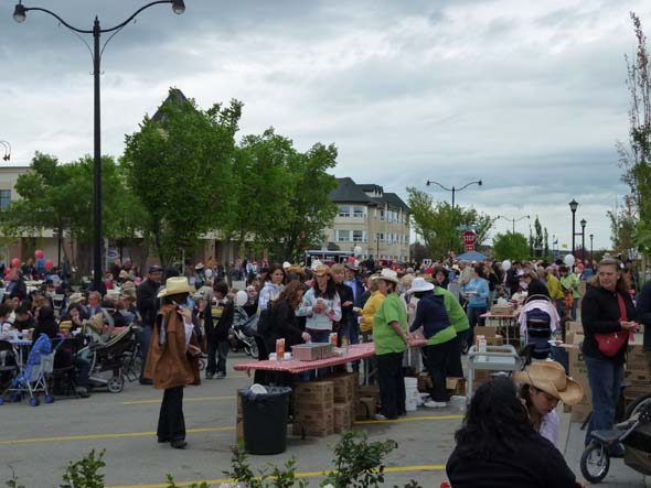 People lining up for free pancakes at a Stampede Breakfast.
